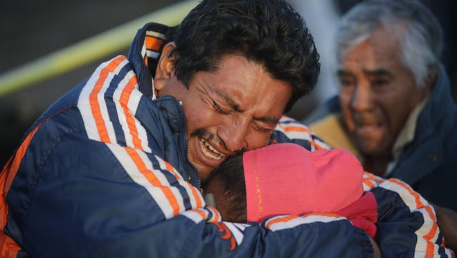 Family members of a victim cry when recognizing the body after an explosion in a pipeline belonging to Mexican oil company PEMEX on January 19, 2019 in Tlahuelilpan, Mexico.