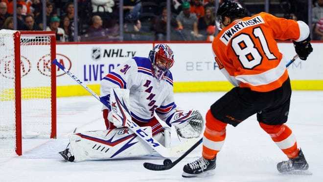 New York Rangers' Igor Shesterkin, left, makes the save on Philadelphia Flyers' Carsen Twarynski, right, during the second period of a preseason NHL hockey game, Saturday, Sept. 21, 2019, in Philadelphia. (AP Photo/Chris Szagola)