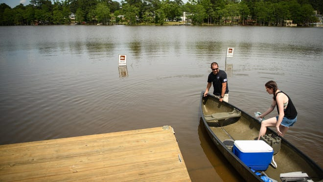 The water in Hope Mills Lake will be lowered Monday to check for damage following an earthquake in the northwestern part of the state. [ANDREW CRAFT/THE FAYETTEVILLE OBSERVER]