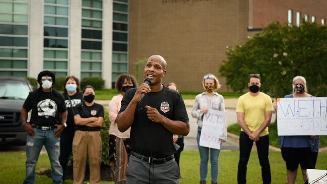 Shaun McMillan, founder of Fayetteville PACT, speaks in front of the Cumberland County Detention Center last month. He has asked the City Council to force the police chief to resign.