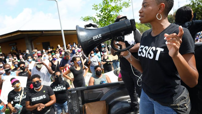 Aeriel Lane, the organizer of the March for Peace in Gainesville, talks to the more than 1,000 people gathered Saturday at Depot Park to start a march in response to the killing of George Floyd by a police officer in Minneapolis.