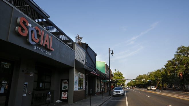Bars and clubs at Midtown along West University Avenue in Gainesville remained closed under state and local orders due to the coronavirus.
