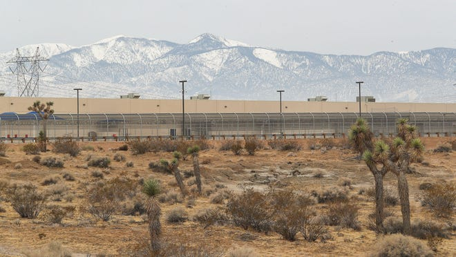 The U.S. Immigration and Customs Enforcement's Adelanto ICE Processing Center sits surrounded by Joshua trees and open desert in Adelanto on Dec. 3, 2019.