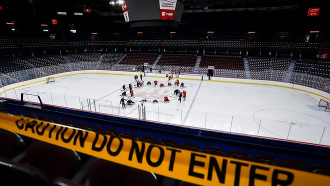Calgary Flames' players take to the ice during NHL hockey practice in Calgary, Alberta, Monday, July 13, 2020.