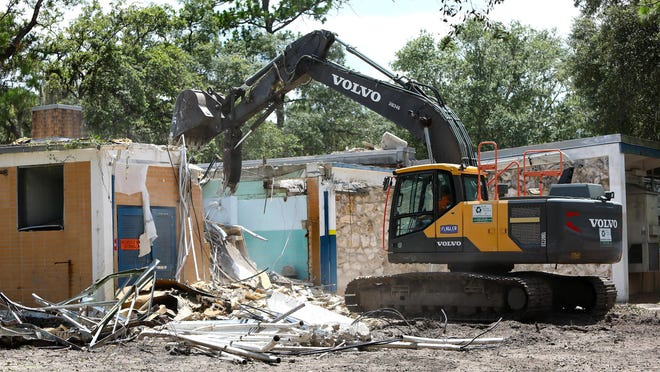 A construction crew starts the demolition of Howard Bishop Middle School in Gainesville Fla. July 14, 2020. The Alachua County School District built a transition school so that Howard Bishop could be demolished and a new school built there.