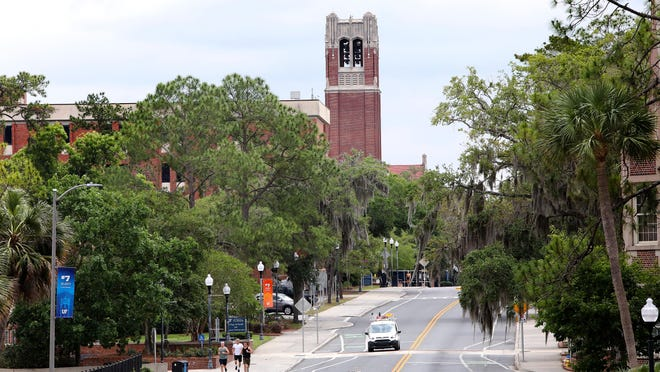 Century Tower is seen on the University of Florida campus shortly after it shut down due to COVID-19. Members of UF's faculty union are asking state leaders to keep classes online for the start of fall semester.