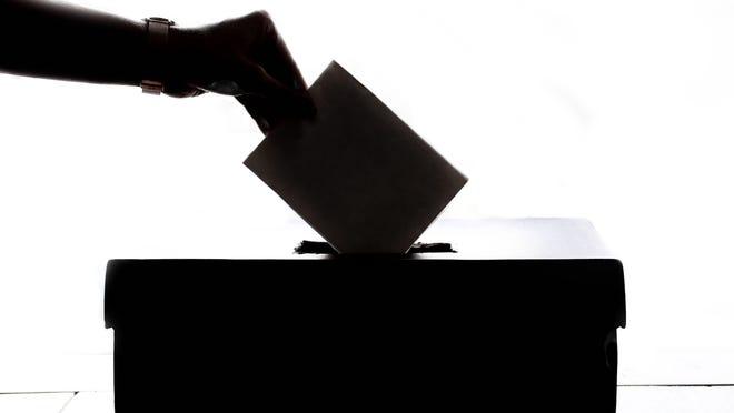 A voter casts a ballot.