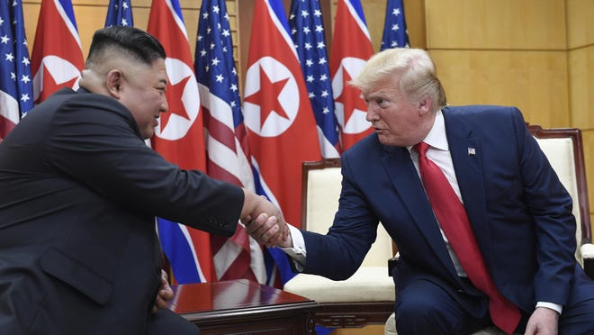 President Donald Trump, right, meets with North Korean leader Kim Jong Un at the border village of Panmunjom on June 30, 2019, in the Demilitarized Zone, South Korea.