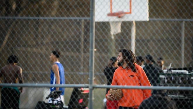 J. Cole films a Puma commercial Jan. 9 on a basketball court near Walker-Spivey Elementary School.
