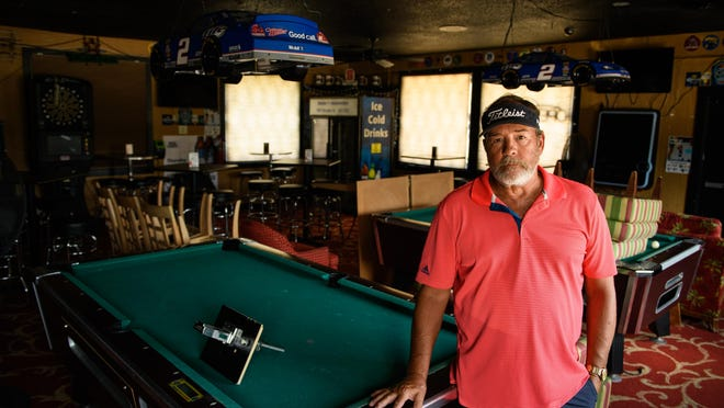 Owner Greg Offenhauser in his bar, Louie's Sports Bar & Pub, which has been closed since mid-March because of the COVID-19 pandemic.