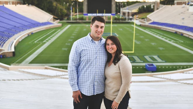 """Matt and Emma Skura form a dynamic partnership. They are shown here at Duke's Wallace Wade Stadium, where Matt played during college. The couple's relationship, said Matt's trainer, is """"on another level."""""""