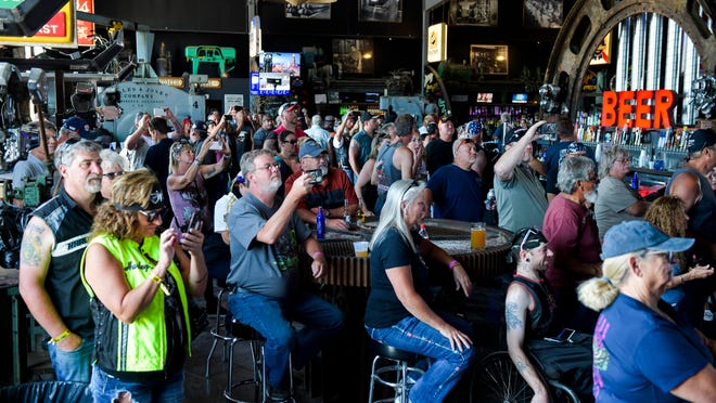 People watch a concert at the Full Throttle Saloon during the 80th Annual Sturgis Motorcycle Rally in Sturgis, S.D., on Aug. 9.