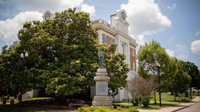 A monument honoring the soldiers of the Confederate States of America stands at the base of the Marshall County County Courthouse in Lewisburg, Tenn., on Thursday, July 2, 2020. The words