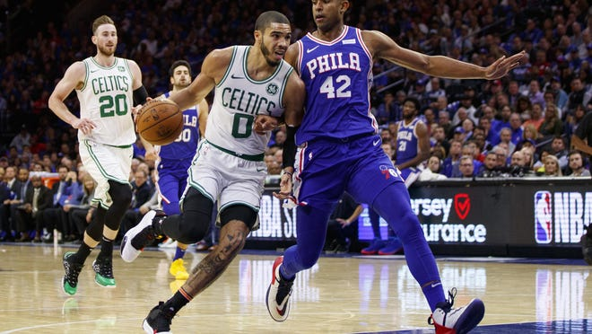 Boston's Jayson Tatum drives to the basket against Philadelphia's Al Horford in a game in October. The former teammates will square off again in the first round of the NBA playoffs, beginning Monday night.