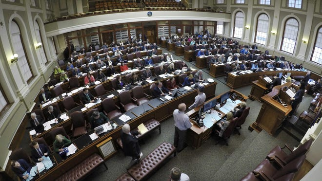 Maine lawmakers convene in the House Chamber at the Statehouse, March 17, 2020, in Augusta, Maine.
