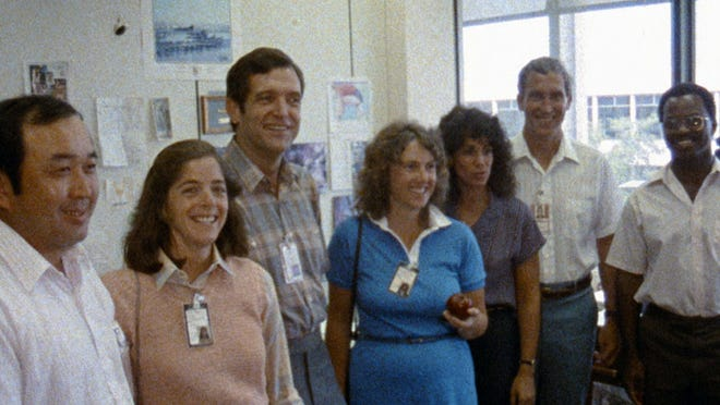 """This image released by Netflix shows members of the Challenger 7 crew, from left, Ellison S. Onizuka; Barbara Morgan, Dick Scobee, Christa McAuliffe, Judith Resnik, Mike Smith, and Ronald McNair in episode 2 of """"Challenger: The Final Flight."""" The four-part series about the 1986  Challenger space shuttle disaster premieres Wednesday."""