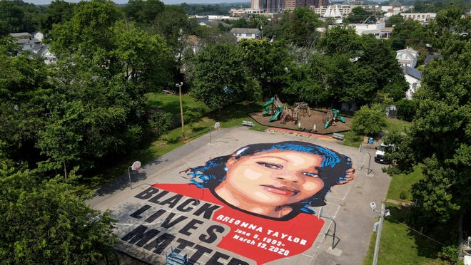 FILE - A ground mural depicting a portrait of Breonna Taylor is seen at Chambers Park, Monday, July 6, 2020, in Annapolis, Maryland. The mural honors Taylor, a 26-year old Black woman who was fatally shot by police in her Louisville, Kentucky, apartment. The artwork was a team effort by the Banneker-Douglass Museum, the Maryland Commission on African American History and Culture, and Future History Now, a youth organization that focuses on mural projects.