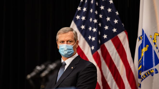 FILE - Gov. Charlie Baker stood behind a podium wearing a blue mask during a press conference where he and several cabinet secretaries detailed the state's response to the COVID-19 pandemic, Tuesday, Oct. 13, 2020.