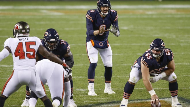 Chicago Bears quarterback Nick Foles (9) waits for the ball from center Cody Whitehair (65) during the second half of s game against the Tampa Bay Buccaneers on Thursday, Oct. 8, in Chicago.