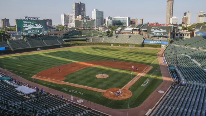 This July 5, 2020, file photo shows Chicago Cubs players during baseball practice at Wrigley Field in Chicago.
