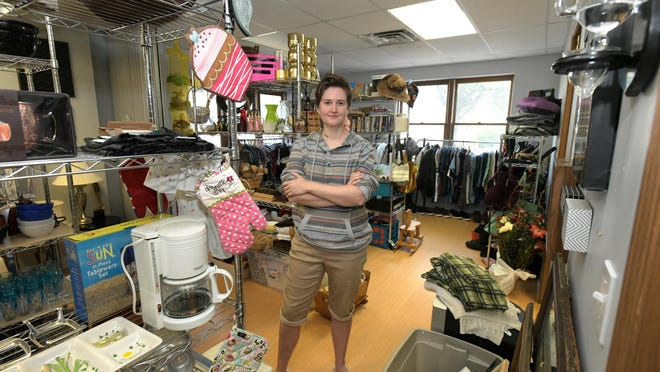Savannah Kutkat stands in the thrift shop she opened in mid-July in East Peoria. Items at Enough Stuff Thrift Shop & Community Space are not priced. Instead, customers can take them for free, make a donation, or sign up to be a part of a monthly subscription service that supports the shop.