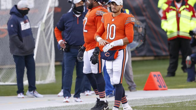 Chicago Bears quarterback Mitchell Trubisky (10) walks on the sidelines during the first half of an NFL football game against the Indianapolis Colts, Sunday, Oct. 4, 2020, in Chicago.