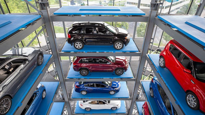 Cars sit on moveable platforms in the vending tower at the new Carvana dealership in Louisville, Kentucky. Aug. 12, 2020.