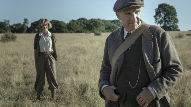 Archeologist Ralph Fiennes checks out a site while landowner Carey Mulligan looks on.