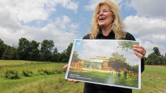 Sabra Jones holds an architectural drawing of a proposed new theater to be built on the site at Upper East Hardwick Street in Greensboro, Wednesday.