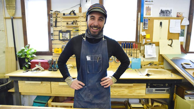 Woodworker Matthew Hastings at his workshop Riven in Burlington's South End.