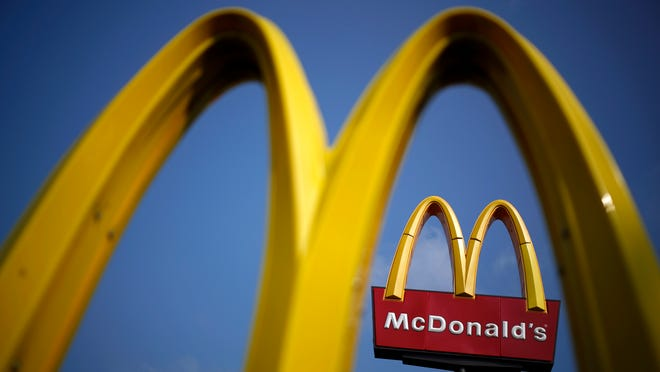 McDonald's Corp. signage stands above a restaurant in Carrolton, Kentucky in this July 21 photo.