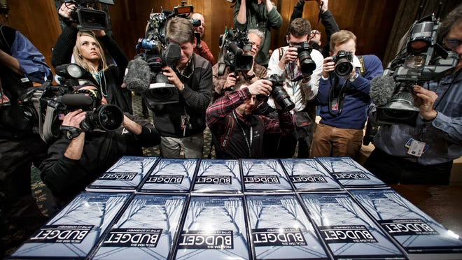 Members of the media surround President Barack Obama's new $4 trillion budget plan as it is distributed Feb. 2 by the Senate Budget Committee on Capitol Hill.