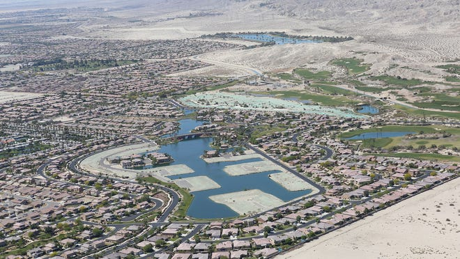 The east valley housing development Terra Lago, center, features a 20-acre lake.