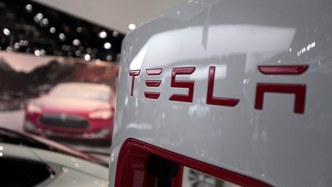 The Tesla Motors Inc. logo is seen on a charging station at the company's booth during the 2014 North American International Auto Show (NAIAS) in Detroit, Michigan in January.