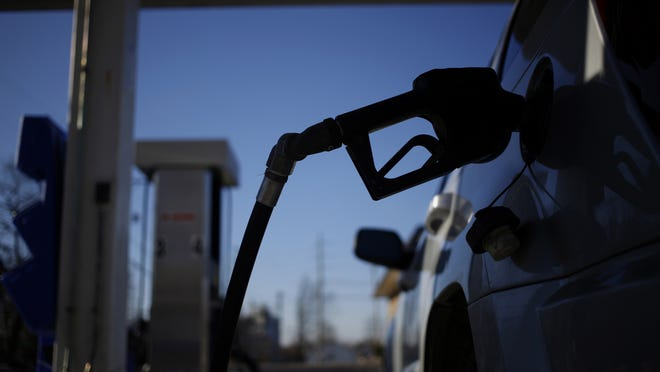A gasoline pump nozzle refuels a sport utility vehicle (SUV). (Luke Sharrett/Bloomberg)