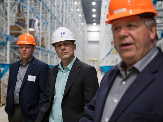 Jason Marquardt (left), Mike Rush, president of Win Chill, and Jeff Davis give a tour of the warehouse in Sioux Falls, S.D. on Tuesday, May 8, 2018.