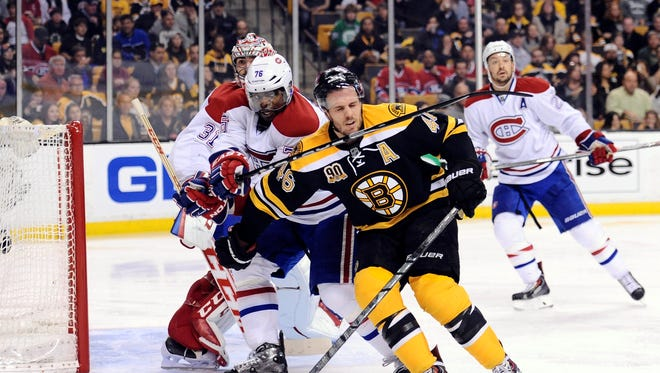 Montreal Canadiens defenseman P.K. Subban (76) high sticks Boston Bruins center David Krejci (46) during the second period in game two of the second round of the 2014 Stanley Cup Playoffs at TD Banknorth Garden.