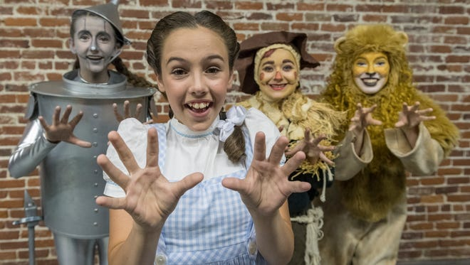 "Abby Jesus is Dorothy with Carly Duerre, left, as The Tina Man, Tara Goodman as the Scarecrow and Briana Byus as the Cowardly Lion in The Ruby Slipper Performing Arts Academy's production of the Valley's first sign language version of ""The Wizard of Oz"". Photo taken on Friday, May 26, 2017. The play features both ASL sign language and spoken translations."
