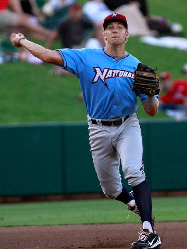 Northwest Arkansas Naturals third baseman Hunter Dozier makes a throw to first during a game against the Springfield Cardinals on Thursday, July 10, 2014.