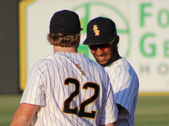 Southern Miss shortstop LeeMarcus Boyd, right, chats with third baseman Taylor Braley during Friday's win over Old Dominion at Pete Taylor Park.