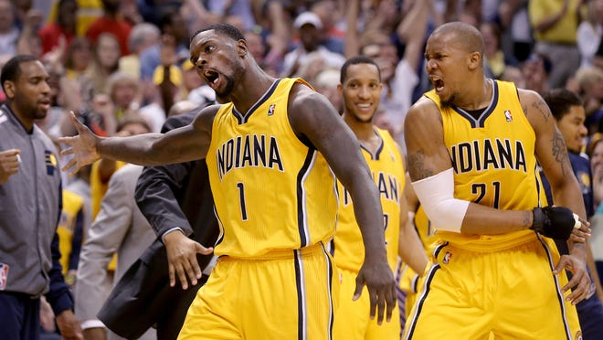 Pacers Lance Stephenson celebrates his triple-double late in the second half of their game Sunday, April 13, 2014, afternoon at Bankers Life Fieldhouse.