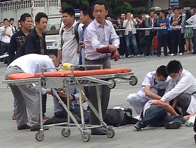 Medical personnel help people who were injured during a knife attack at a railway station on May 6 in Guangzhou, China.  Six people were wounded in the attack.