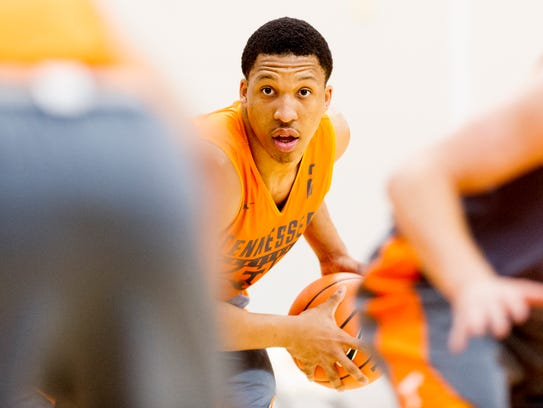 Grant Williams (2) looks to pass the ball during team