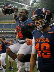UTSA defense including Kevin Strong Jr. celebrates after their last team's last touchdown  during the second half of NCAA college football game against Southern Mississippi at the Alamodome, Saturday, Oct. 8, 2016, in San Antonio, Texas.