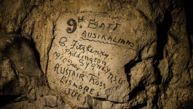 Names engraved on the walls of a former chalk quarry, at the Cite Souterraine, Underground City, in Naours, northern France by 9th Batt Australians, G. Fitzhenry of Paddington, Sydney from 1916 July and Alistair Ross, Lismore, Australia. The names are just some of nearly 2,000 First World War inscriptions that have recently come to light here, a two-hour drive north of Paris, thanks to efforts by Jeffrey Gusky, the site's new owners and local archaeologist Gilles Prilaux.