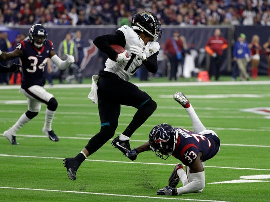 Jacksonville Jaguars wide receiver D.J. Chark (17) runs past Houston Texans defensive back A.J. Moore (33) during the second half of an NFL football game, Sunday, Dec. 30, 2018, in Houston. (AP Photo/David J. Phillip)