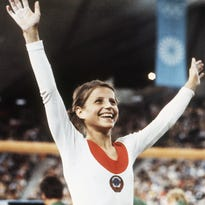 Former Olympic gymnast sells gold medals at auction