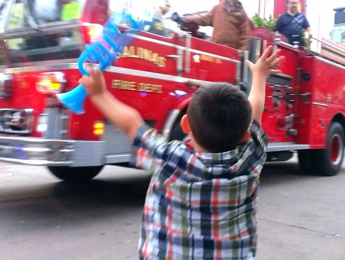 Jacob Torrez, 3, is excited to see the fire truck at the Kiddie Kapers parade.