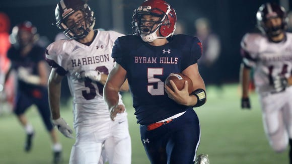 Byram Hills' Matthew Weiler (5) runs for a first half touchdown against Harrison during first half action at Byram Hills High School in Armonk Sept. 28, 2018.