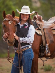 Tenille Rhodes poses for a photo with her horse Boomer at her home in Kanarraville, May 27, 2016.